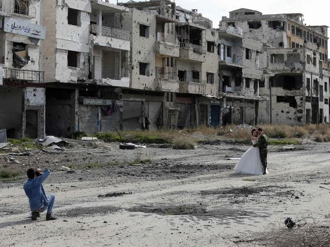 Wreckage ... the photos depicted the eeriness of the destroyed Syrian town of Homs. Picture: AFP/Joseph Eid