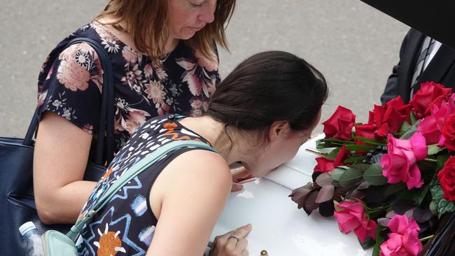 A mourner kisses the coffin at the funeral for Jessica Falkholt. Picture: AAP/Ben Rushton.