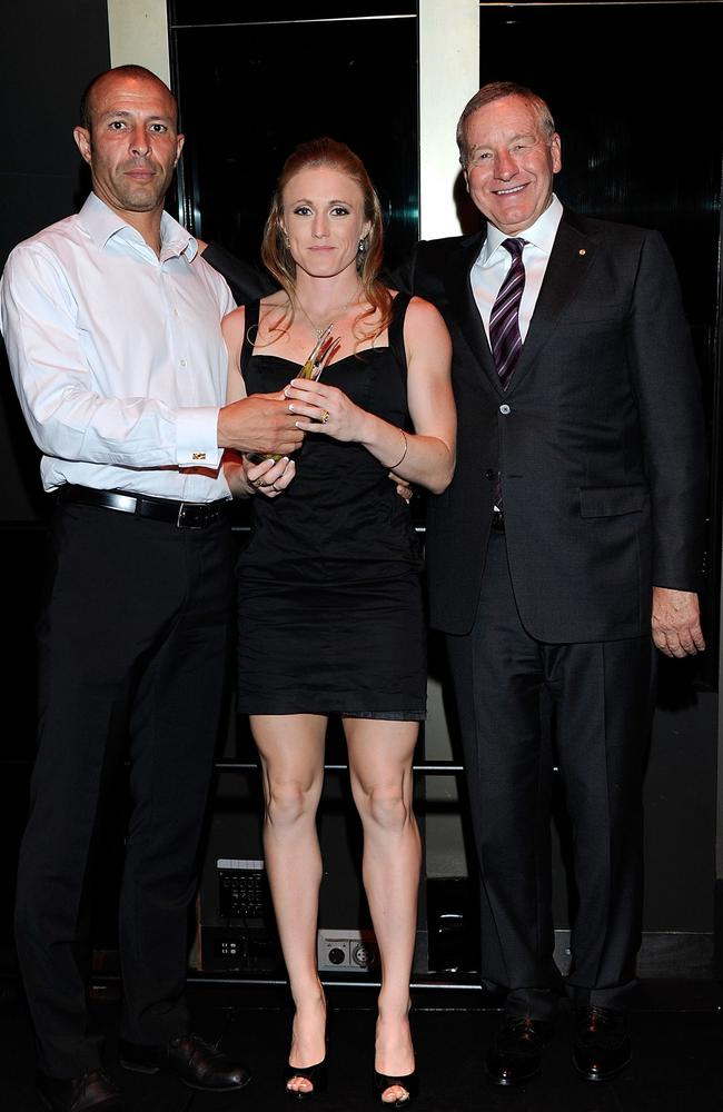 Sally Pearson and Eric Hollingsworth pic up an award in 2011.