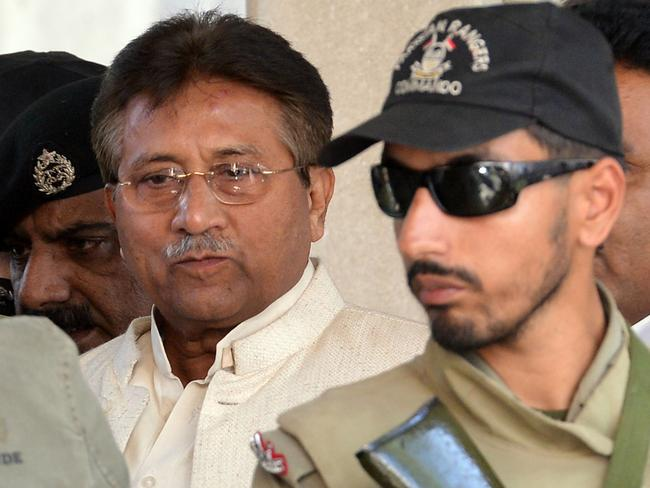 Former Pakistani president Pervez Musharraf, left, is escorted by paramilitary soldiers as he leaves the Pindi High Court after a hearing in Rawalpindi in 2013. Picture: Aamir Qureshi/AFP