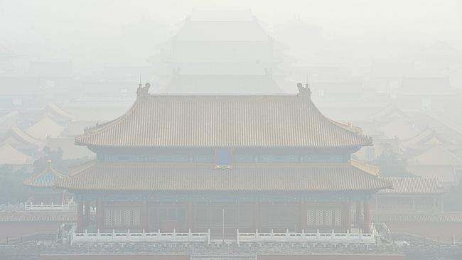 Imagine if you couldn't see the Opera House on Sydney Harbour. This is what the Palace Museum, a major landmark, looks like during heavy smog. Picture: AP