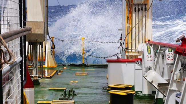 Tough work ... Waves crash over the back deck of Fugro Discovery during search for MH370 in the southern Indian Ocean. Pic: Supplied.