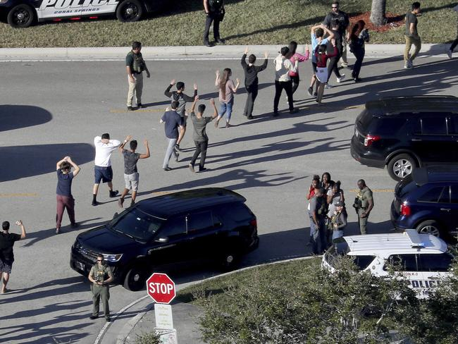Students flee the scene of the shooting. Picture: AP