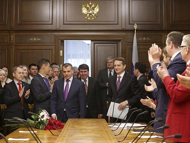 Welcome mat...Russian parliament speaker Sergei Naryshkin, background right, welcomes Crimea's prime minister Sergei Aksyonov to talks in Russian Parliament in Moscow. Picture: AFP