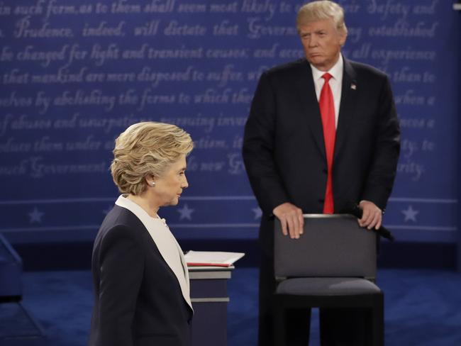 In this file photo, Democratic presidential nominee Hillary Clinton walks past Republican presidential nominee Donald Trump. Picture: AP.