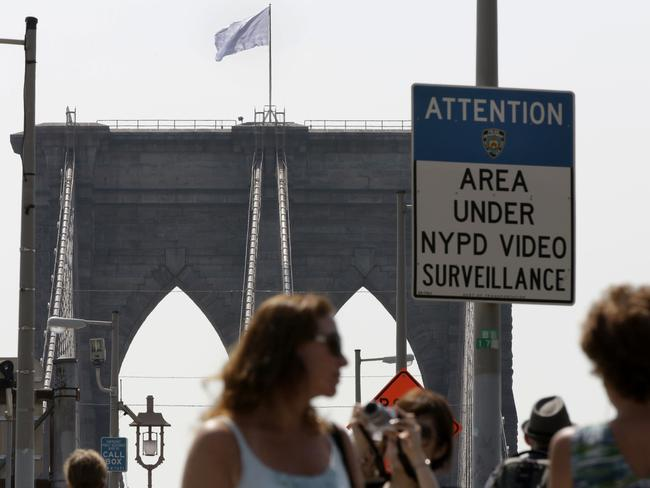 Brazen stunt ... New York's Brooklyn Bridge is under heavy surveillance, which makes the appearance of the white flags all the more puzzling. Picture: Richard Drew