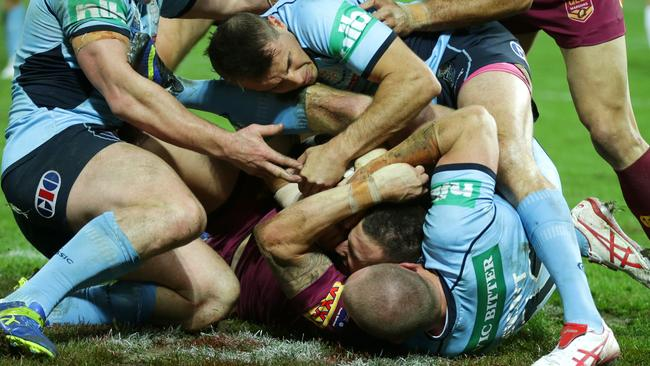 QLD's Darius Boyd is stopped short of scoring a try.