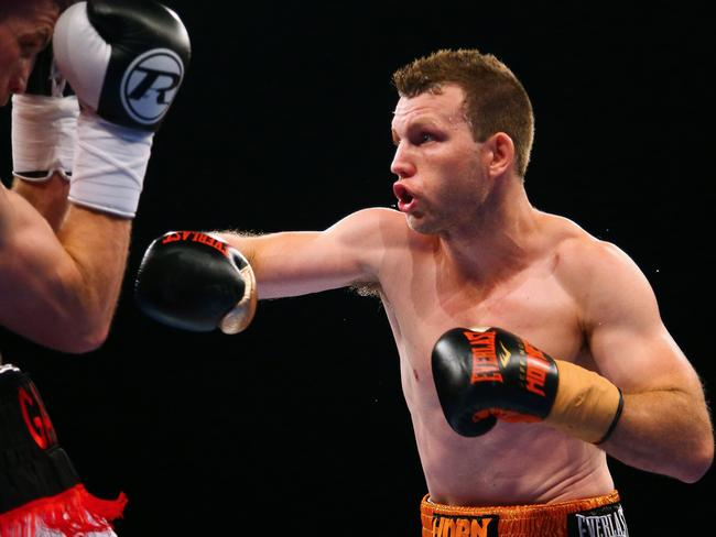 Jeff Horn unloads punches against English boxer Gary Corcoran.