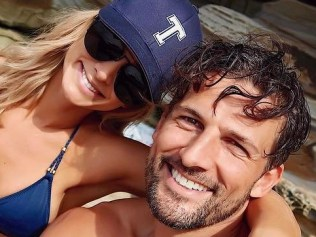 "Anna Heinrich and Tim Robards soak up the sun at Wattamolla beach ... ""Rock on"" Picture: @annaheinrich1/Instagram"