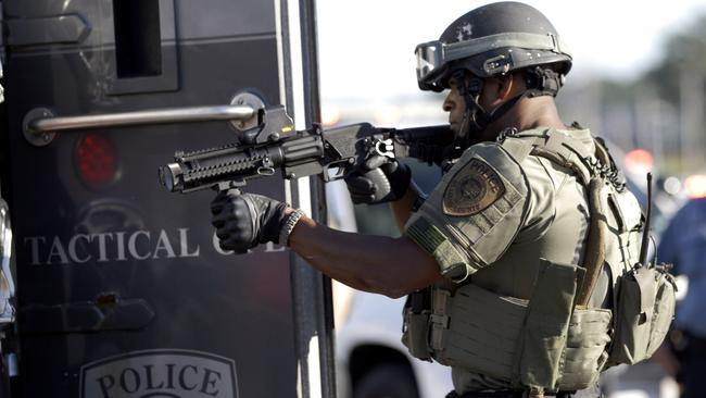 Fear factor ... the officer's uniforms could easily be mistaken for a soldier's. Picture: AP Photo/Jeff Roberson