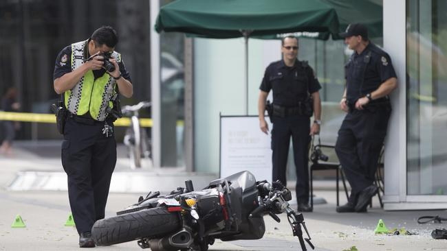 A police officer photographs a motorcycle after a female stunt driver working on the movie Deadpool 2 died after a crash on set.
