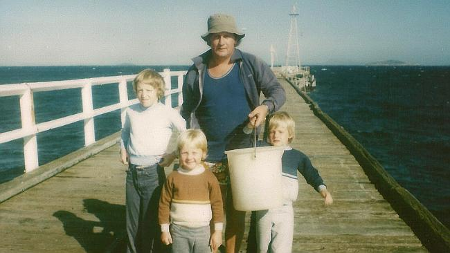 A three-year-old Nathan Morris (in the brown jumper) with his brother Graydon (right) his dad Brian, and his cousin Kathy (left).