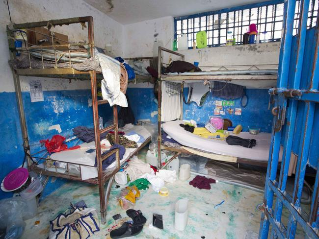 A prison cell is empty after over 100 inmates escaped when they overpowered guards who were escorting them to a bathing area. Picture: AP/Dieu Nalio Chery