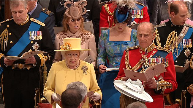 A family affair: The Queen and Prince Philip sing during the ceremony. Back row left to right, Prince Andrew, his daughters princess Beatrice and Eugenie and Prince Edward. Picture: AP