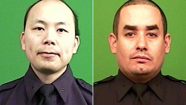 Shot point blank ... Two uniformed NYPD officers, Rafael Ramos and Wenjian Liu, were shot dead on Saturday, December 20, while sitting in their marked police car on a Brooklyn street corner.