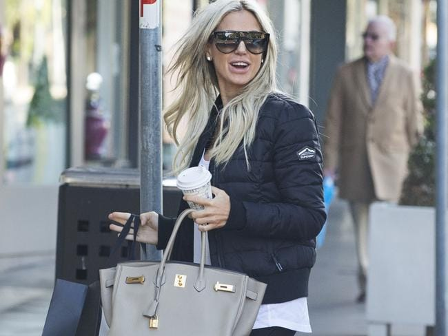 Roxy Jacenko arrives at her place of work at Paddington after leaving her place at North Bondi on her way to  Her husband Oliver Curtis is expected to be released from prison on Thursday at midnight. Pic Jenny Evans