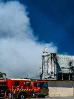 Emergency services continue to work on the huge fire at the Thomas Foods abattoir in Murray Bridge the morning after it broke out. Picture: AAP / Roy Vandervegt