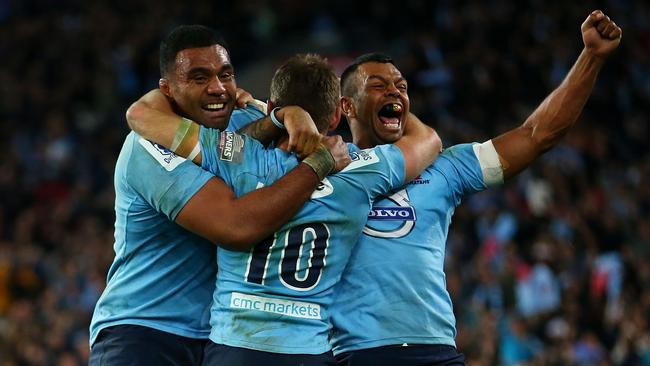 Wycliff Palu, Bernard Foley and Kurtley Beale celebrate winning the Super Rugby final.