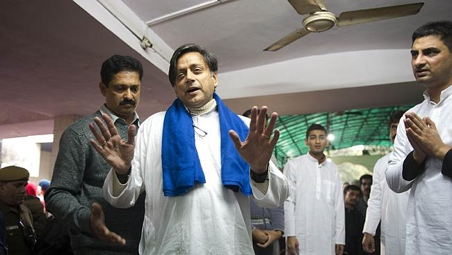 "India's Human Resources Minister Shashi Tharoor attending the ceremonial cremation of his wife following her ""un..."