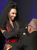 French designer Jean-Paul Gaultier, right, and Austrian singer and Eurovision Song Contest winner, Conchita Wurst, hold hands at the end of the Jean-Paul Gaultier Fall-Winter 2014-15 Haute Couture collection, presented in Paris. Picture: AP