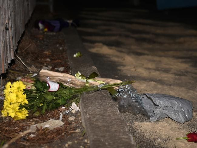 Flowers at the scene where gangland lawyer Joe Acquaro was gunned down in Melbourne.