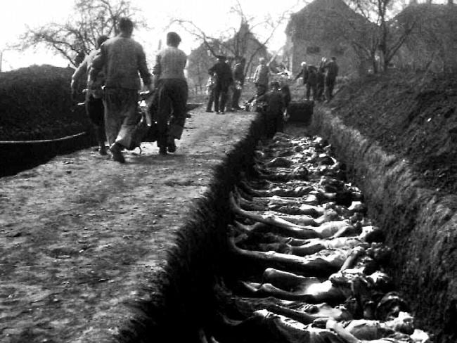 Rows of bodies await burial in pits at Nordhausen, after the liberation of the Nazi death camp by the United States. The IBM machines recorded for the Nazis how their prisoners died.