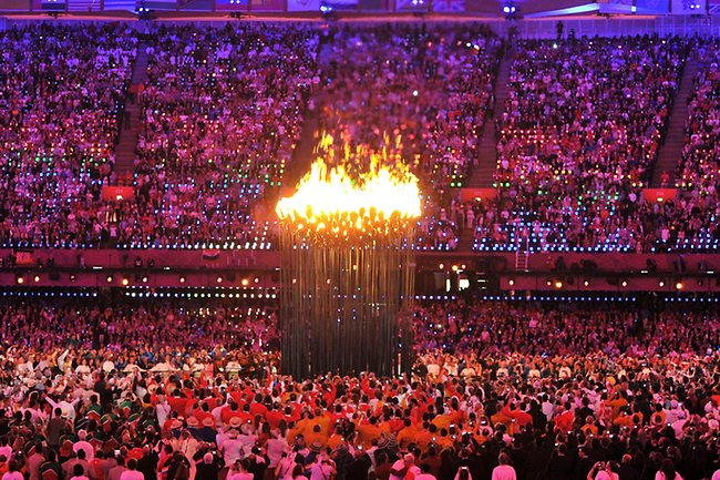 The Olympic flame is lit during the Opening Ceremony of the 2012 Olympic Summer Games at the Olympic Stadium in London, Saturday, July 28, 2012. (AP Photo/John Stillwell, Pool)