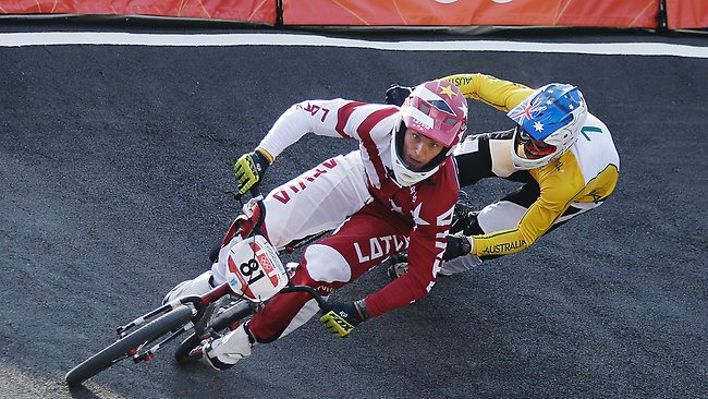 Latvia's Maris Strombergs stays ahead of Australia's Sam Willoughby to win his second straight Olympic gold medal in BMX cycling.