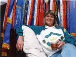 Gillian Rolton in front of a collection of equestrian event ribbons in 1995.