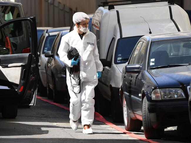 A forensics expert leaves after gathering evidence at the home of one of two men arrested in Marseilles. Picture: AFP