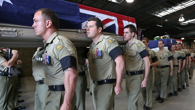 The caskets of the three members are escorted from the Memorial Service. Picture: Department Defence