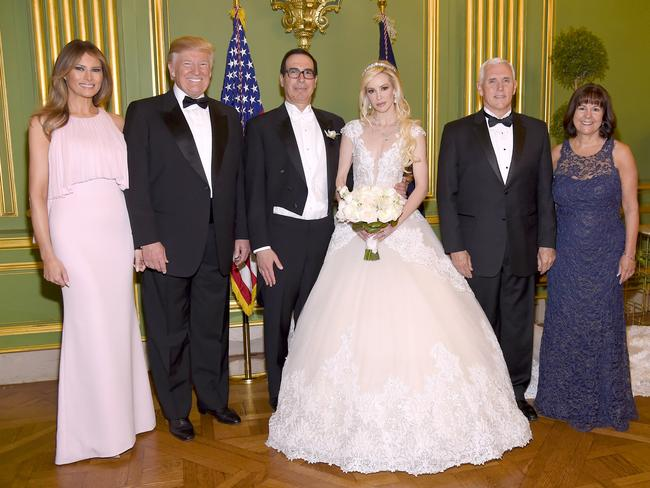 First Lady Melania Trump, President Donald Trump, Secretary of the Treasury Steven Mnuchin, Louise Linton, Vice President Mike Pence, and Second Lady Karen Pence pose at the wedding of Mnuchin and Louise Linton. Picture: Kevin Mazur/Getty Images for LS