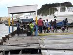 People recover broken parts of the dock after the passing of Hurricane Irma, in St. John's, Antigua and Barbuda, Wednesday, Sept. 6, 2017. Picture: AP Photo/Johnny Jno-Baptiste
