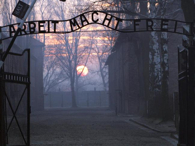 The infamous sign 'Arbeit macht frei' at the entrance of former World War Two (II) Nazi concentration Auschwitz in Polish town of Oswiecim in 13/01/2005 file photo. Thieves have cut through a barbedwire fence and stole the sign in early hours of 18/12/2009 and has sparked outrage as police launched a hunt for the perpetrators.