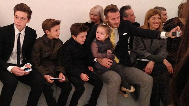 Proud papa...David Beckham takes selfie with his four children in the front row before the Victoria Beckham show during Fashion Week in New York. Picture: AP