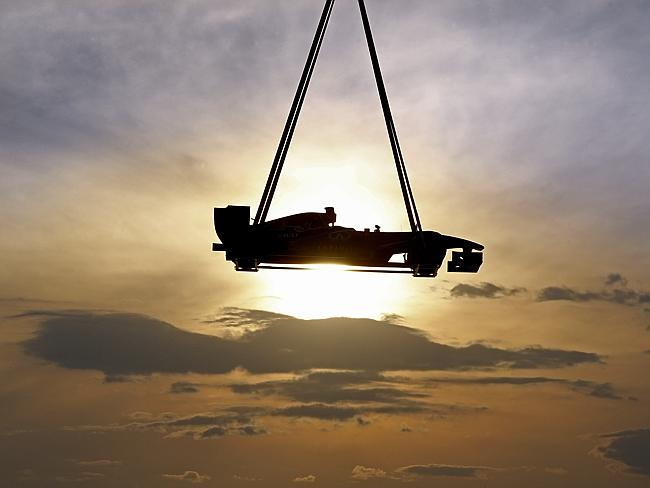 A helicopter carries a Formula One car above Melbourne in a spectacular stunt. Picture: David Caird