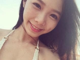 World's most beautiful dental nurse - Ning Chen, 25, became a huge hit in her native Taiwan after seductive snaps of her posing in her pink uniform took the web by storm. Picture: Viral Press