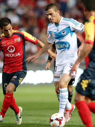 James Troisi takes on the Adelaide defence while playing for Victory.
