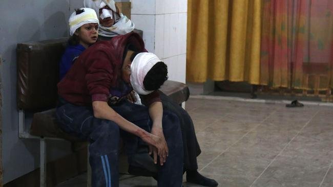 Wounded Syrians wait to receive treatment at a makeshift hospital in Kafr Batna. Picture: Ammar Suleiman/AFP