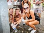 Rhianne Pepper, Samantha Howard and Leena Dovel fill up their water bottles. Picture: Attila Szilvasi