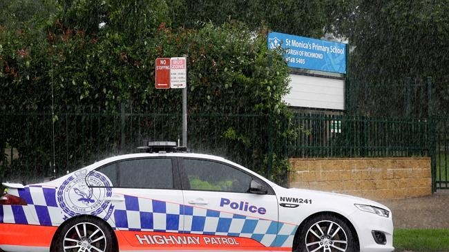 Police outside St Monica's Catholic School in Richmond. Picture: PETER KELLY