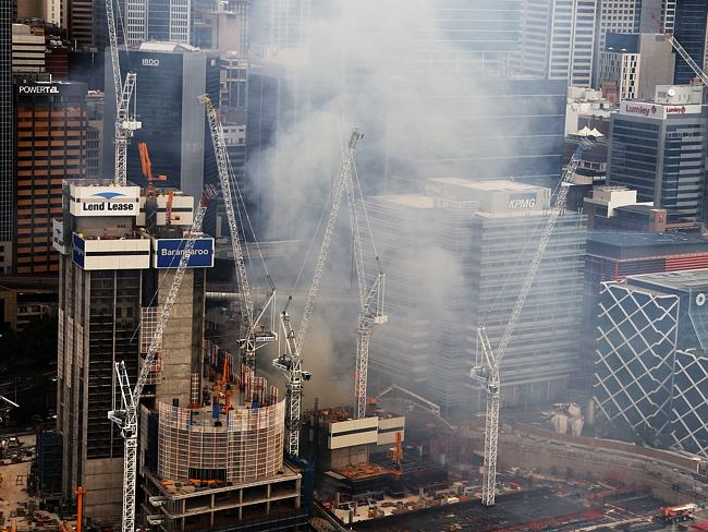 The fire and smoke has caused traffic chaos around the CBD and forced workers to be evacuated with a risk of the crane collapsing. Picture: Toby Zerna