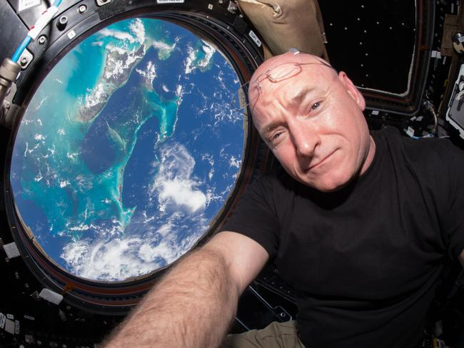 Astronaut Scott Kelly takes a photo of himself inside the Cupola, a special module of the International Space Station which provides a 360-degree viewing of the Earth and the station. Picture: Scott Kelly/NASA via AP