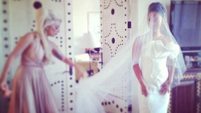 Maid Of Honour Lady Gaga, adjusts the bride's veil. Picture: Twitter