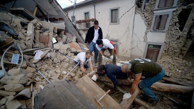 Resident search for victims in the rubble after a strong heartquake hit Amatrice in Central Italy. Picture: AFP / Filippo Monteforte.
