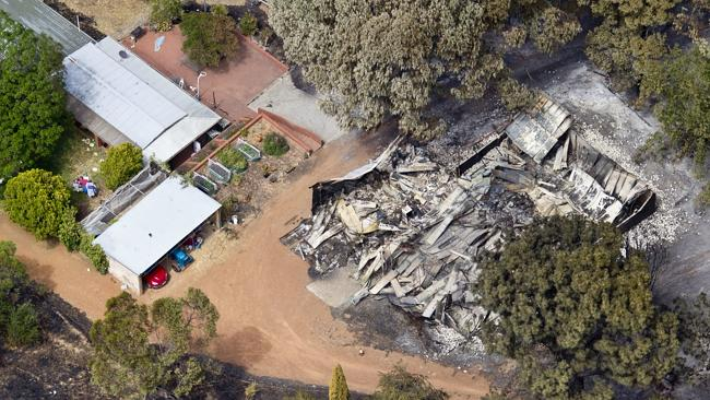 The loss of homes and property in the Perth Hills region can be seen from the air after a massive fire swept through the region on Sunday. Picture: Matthew Poon