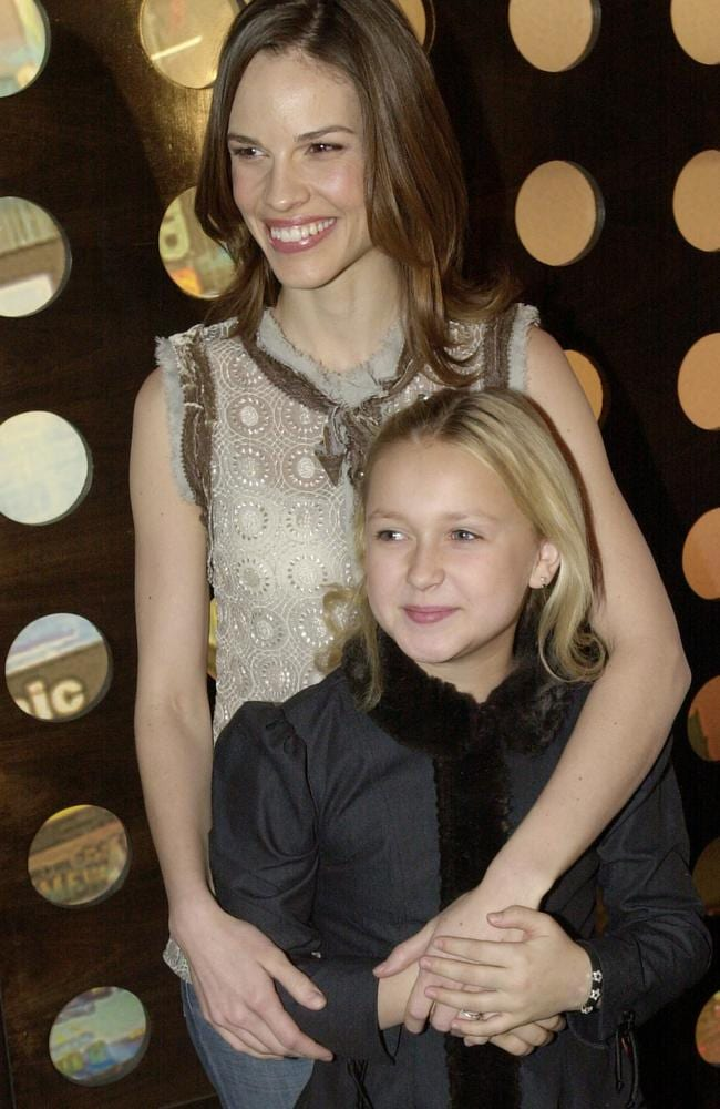Hilary Swank and Skye McCole Bartusiak, 10, during a photo call in New York, 2003.