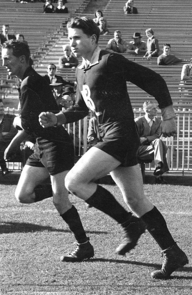 Alan White (left) runs alongside a young John Nicholls at the MCG in 1957. Picture: Mark Griffin