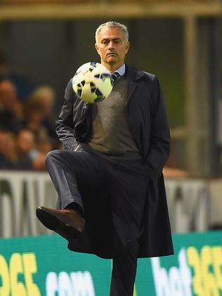 Manager Jose Mourinho of Chelsea shows a cool touch.