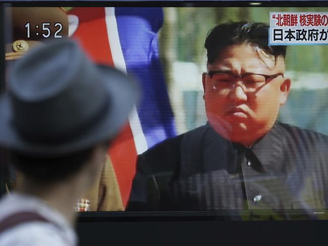 A man watches a TV news program about North Korea's possible nuclear test on a public screen in Tokyo. Picture: AP Photo/Eugene Hoshiko